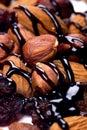 Hazelnuts, almonds and raisins with chocolate topp Royalty Free Stock Photo