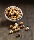 Hazelnuts on brown wooden table in a bowl Royalty Free Stock Photo