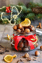 Hazelnuts and christmas spices in a jar on a festive background Royalty Free Stock Photo