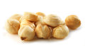 Hazelnuts closeup view of on white background Stock Photos