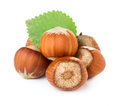 Hazelnuts with green leaves isolated on white background Stock Photos