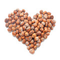 Hazelnuts in shape of heart isolated on white background Stock Image