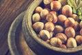 Hazelnuts on wooden background Royalty Free Stock Photo