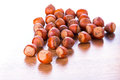 Hazelnuts on the wooden board Stock Image