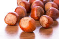Hazelnuts on the wooden board Stock Photography