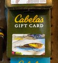 stock image of  An image of a fishing-themed Cabela`s gift card, Father`s Day idea