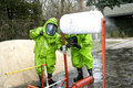 Hazmat response team stopping a leak hazardous material in action of dangerous chemical substance Stock Image