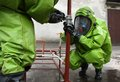 Hazmat response team at work hazardous material in action fighting a leak of a dangerous chemical substance Royalty Free Stock Photo
