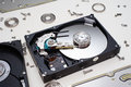 Hdd inside disassembled parts of a hard disc drive Royalty Free Stock Photo