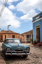 HDR Cuba caribbean blue classic car parked on the street in Trinidad Royalty Free Stock Photo