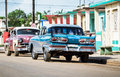 HDR Cuba countryside american blue vintage car parked on the road Royalty Free Stock Photo