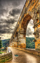 HDR image of Pont du Gard, ancient Roman aqueduct listed in UNES Royalty Free Stock Photo