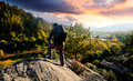 Hdr mountainer young look in to beautiful colorful sunset adventure landscape Stock Images