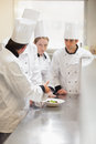 Head chef explaining something to class explaing in kitchen Royalty Free Stock Photo