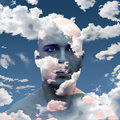 Head in clouds man with Royalty Free Stock Image