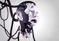 The head of a cyborg with wires on a gray background.