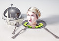 Head on a dish portrait of the of beautiful woman standing table Royalty Free Stock Photos