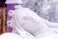 Head of a feminine statue dead sleeping detailed view the made white marble from the baroque church st teresa in palermo landscape Stock Photo
