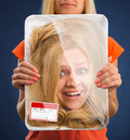 Head in food tray surprised female wrapped Royalty Free Stock Images