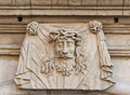 Head of jesus christ stone carving in relief the wearing the crown thorns on the exterior a building Stock Photography