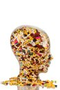 Head made of glass with tablets a filled many photo icon for drugs abuse and addiction Royalty Free Stock Photo
