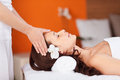 Head massage relaxing fresh woman having in spa Royalty Free Stock Photography