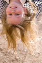 Head over heels face of little girl Stock Photo