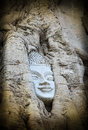 Head of Sandstone Buddha overgrown by Banyan Tree Stock Images
