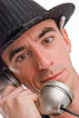 Head shot caucasian male wearing pin striped hat talking telephone appears to be journalist pen tucked behind his ear Stock Image