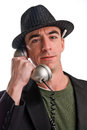 Head shot caucasian male wearing pin striped hat talking telephone appears to be journalist pen tucked behind his ear Stock Images