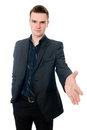 Head and shoulder portrait of young businessman holding his arm out for a handshake Royalty Free Stock Images