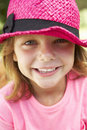 Head And Shoulders Portrait Of Girl Wearing Pink Straw Hat Royalty Free Stock Photo