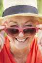 Head And Shoulders Portrait Of Smiling Senior Woman Wearing Sunglasses Royalty Free Stock Photo