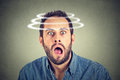 Head is spinning. Surprise astonished man. Royalty Free Stock Photo