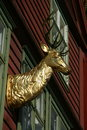 Head of a stag in gold as a wall decoration house norway Stock Photography
