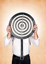 Head target man holding dartboard on orange background Royalty Free Stock Photography