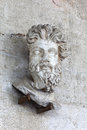 Head of a Triton on wall Royalty Free Stock Photo