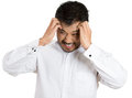 Headache closeup portrait worried young man having really bad hurt pain placing both hands on temples isolated white background Royalty Free Stock Image