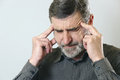 Headache frustrated senior man holding his head suffering from Stock Images