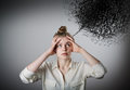 Headache. Girl in white and chaos. Royalty Free Stock Photo