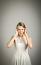 Headache girl in white suffering from expressions feelings and moods Stock Photos