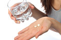 Headache hand with pills medicine tablets Royalty Free Stock Photo