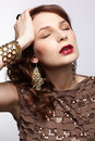 Headache portrait of beautiful young brunette woman in various jewellery having symptoms of Stock Image