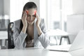 Headache and Stress at Work. Portrait of Young Business Woman at Royalty Free Stock Photo