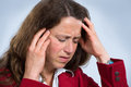 Headache woman in red jacket has sufferers Royalty Free Stock Photos