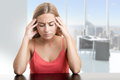 Headache woman suffering from an holding her hand to the head in an office Royalty Free Stock Images