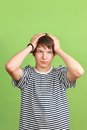 Headaches teen teenage boy with headache holds head with hands Royalty Free Stock Image