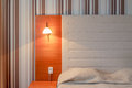 Headboard and bed in a clean hotel room Royalty Free Stock Photo
