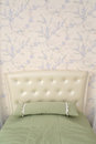 Headboard of a single bed with a throw pillow. Modern classics w Royalty Free Stock Photo