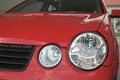 Headlamp modern halogen on red car Stock Image